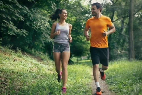 Couple jogging down a trail- PEMF Health Inc.