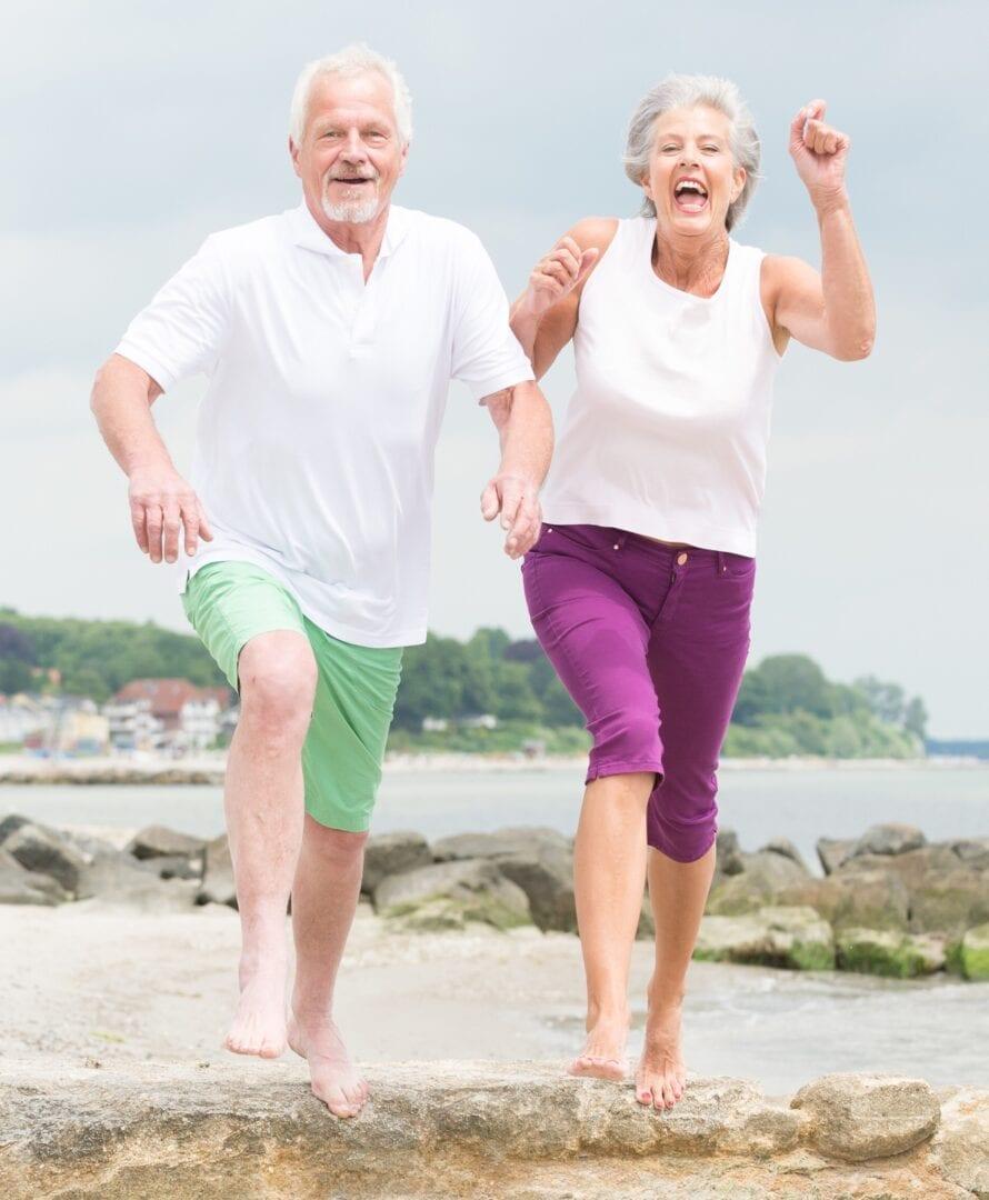 Senior Couple Smiling jogging waterfront- PEMF Health Inc.