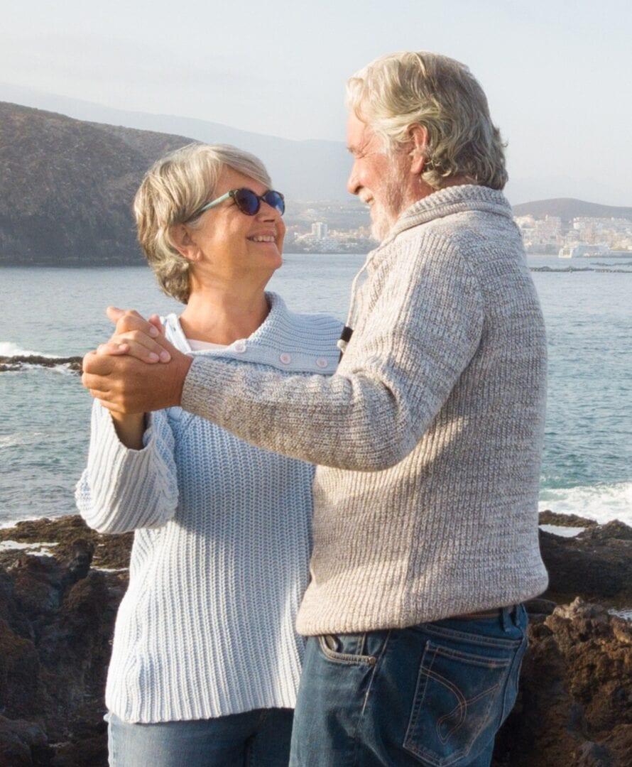 Smiling Seniors waterfront dance pose- PEMF Health Inc.